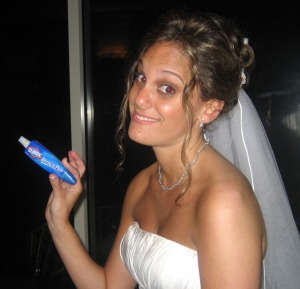 My wife holding her most important wedding day accessory.